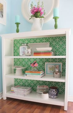 belle maison: Inspiration Snapshot: DIY Bookcase Makeover. Use a stencil or wallpaper to cover inside of bookcase.