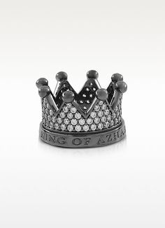 €210.00 | Re Silver and Zircon Crown Ring, has a regal attitude showing just who rules your fashion world. Featuring crown circlet encrusted in hand set black cubic zirconia crystals with etched logo 'King of Azhar.' Gunmetal rhodium plated 925 sterling silver. Made in Italy. Custom size.