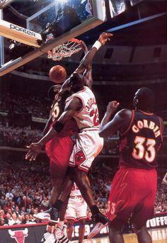Michael Jordan dunks on Dikemebe Mutumbo in Air Jordan XII Playoffs