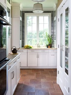 love the one square of gray tile around the window. And this floor tile!