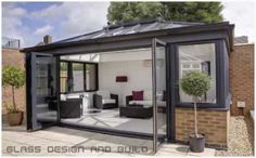 The Quantal aluminium conservatory roof is strong and visually stunning. ✅ Equates More Light ✅ Free Online Aluminium Conservatory Quote. Rooftop Design, Rooftop Terrace, Patio Design, Garden Room Extensions, House Extensions, Modern Conservatory, Orangery Conservatory, Gazebo, Pergola