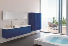 Blue accents make a major statement in this modern bathroom completed by Pedini Miami. #luxeFL