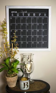 """Looking to get organized? This Monthly Chalkboard Calendar is 2 ft x 2 ft, framed, magnetic and hand painted! Each day's square is 3.25"""" wide by 3.75"""" tall so there is LOADS of space for you to write your daily events in! And you can choose whether to start your week on Sunday or Monday! Check out the other layouts, board sizes and command centers on Etsy. Or request a custom order instead and have something made just for you! Happy Planning! By the Neat Freak Studio"""