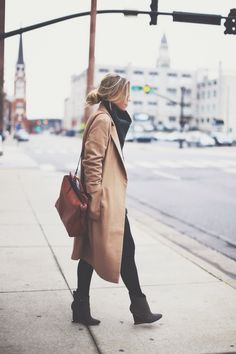 camel coat and lovely black wedge ankle boots