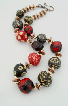 necklace of paper mache beads painted.