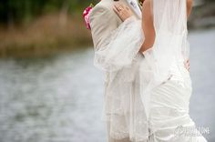 Intimate moment between the bride and groom by the water - by Footstone Photography www.footstonephotography.com