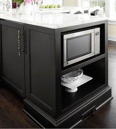 open shelf on island, with microwave spot.