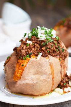 Enchilada Stuffed Sweet Potatoes Serves 4 Ingredients •	3-4 medium sweet potatoes •	1 tbsp ghee or coconut oil •	1 small onion, diced •	5 garlic cloves, minced •	1 lb ground beef (or chicken) •	¼ cup chili powder •	1 tbsp cumin •	1 tsp salt •	2 cups tomato sauce (or a 15oz can)