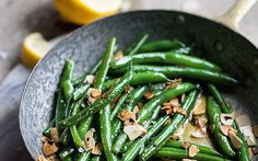 A classic side dish of green beans warmed through in melted butter with crunchy almonds, given a refreshing citrus twist Green Beans With Almonds, Chorizo And Eggs, Banting Recipes, Vegetarian Recipes, Christmas Lunch, High Fat Diet, Lemon Butter, Toasted Almonds, Daily Meals