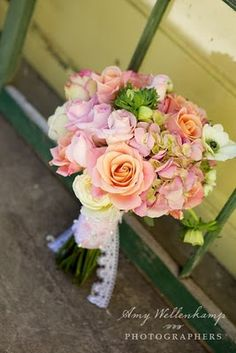 Bridal Bouquet:curly willow, flowering branch, peach and pink/yellow roses, garden roses, hydrangeas (PALE pink, green, white, back up lace hydrangeas), peonies, green apples, freesia, buplerum, anemones, crespedia, pale green moss, tiny blue robin's eggs, white football mums, ranuculus, gerbs. Photographer: Amy Wellenkamp Photography Venue: Family Ranch-Cambria Florist: Fleur~Flowers