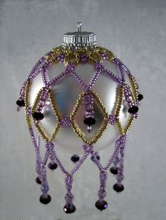 Gold and Purple Sabrina Ornament by KathysBeadTreasures on Etsy (sold? Crochet Christmas Trees, Handmade Christmas Decorations, Christmas Ornaments To Make, Homemade Christmas, Christmas Crafts, Beaded Ornament Covers, Beaded Ornaments, Felt Ornaments, Glass Ornaments
