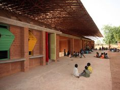 one of the eleven architectural projects featured in the show is a primary school in gando, burkina faso, africa by architect diebedo francis kere.