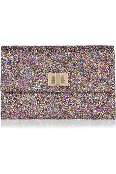 Dazzle and shine this party season with Anya Hindmarch's fabulous glitter-finish clutch. Splashed with myriad jewel-bright colors, this leather and suede-lined accessory will add glamour to everything from cocktail separates to your black tie portfolio.