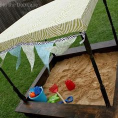 Such a cute sand box! The sun shade is an excellent idea. Too bad fabric UV degrades so quickly. . . =(