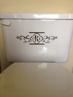 Decorative toilet.... taking monogramming waaaay too far. Now I have seen everything monogrammed!!!! Not sure I am ready for this.