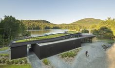 This handsome timber building by the lake looks like a sumptuous holiday retreat, but rest assured it's open to the public for all to enjoy. Canadian design studio Anne Carrier Architecture completed the visitor center in Quebec's Mont Orford National Park and skillfully blends the building into the landscape using a black-stained facade and green roof. The building, known as the Bonnallie Services Center, is one of several design projects the architecture firm has completed for the…