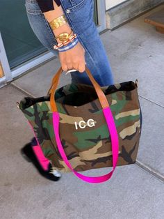 The lil EASY(small batch)- CAMO-with navy and pink side stripe-PINK strap from Parker Thatch Camouflage, Tote Bags, Popular Backpacks, Diaper Bag Backpack, Diaper Bags, Simple Bags, Easy Bag, Fabric Bags, Leather Handle