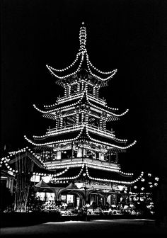 Tivoli Gardens Pagoda Bw.  Tivoli Gardens first opened in1843 and is one of the world's most delightful amusement parks. The iconic pagoda. built in 1900. is a stunning centerpiece on warm summer nights. If there is such a thing as a genuine fantasy park, it surely must be Tivoli.