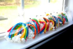 Isn't this the best idea ever for a rainbow party? Just rainbow licorice and marshmallow clouds in a favor bag. Sunny and adorable. Find the idea HERE at Catch My Party.