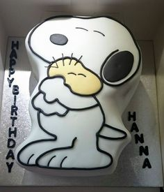 Snoopy shaped vanilla madeira cake, covered in sugarpaste icing.