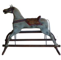 Antique Hobby Horse  USA  Late 19th Century  A beautiful early hobby horse on original stand that moves, Leather Saddle, real horsehair tail, great old paint
