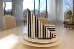 Learn how to fold a napkin like a sailboat!    http://betweennapsontheporch.net #parties  #partydecor #entertaining