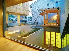 Courtyard home designs ideas in beautiful wood material by korean architect.