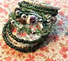 Emerald Green and White Memory Wire Wrap Bracelet with Ceramic Purple and White Beads, Gift for Her, Sandy Hook Elementary Awareness SHE1725 by BlingItOutLoudCharms on Etsy