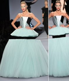 Victor and Rolf, 2010 Illusion dress.I had to look this up.there is a tiny black tube dress in the center.you'd see it if she weren't against a black background. Style Couture, Couture Mode, Couture Fashion, Fashion Art, Runway Fashion, High Fashion, Fashion Show, Fashion Design, Fashion Trends