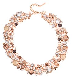 Rose gold-tone statement necklace glowing with facetted acrylic stones and sparkling rhinestones in delicate colours.
