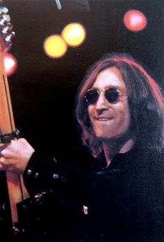 John playing a Fender Stratocaster with capo: The Beatles Guitars