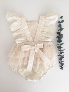 Ive added a beautiful flutter to the straps of the ever so popular ivory tulle romper. This romper is perfect for all occasions! Birthdays photo shoots weddings blessings days - Baby Girl Dress - Ideas of Baby Girl Dress Baby Girl Dresses, Baby Outfits, Baby Dress, Cute Outfits, Baby Wedding Outfit Girl, Baby Girl Romper, Baby Ruffle Romper, Baby Girl Birthday Outfit, Fashion Kids