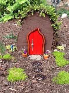 My #fairy garden. Now all I need is some grandchildren to explain why I have a fairy garden. Love the DIY door made for me by my stepson. #garden#