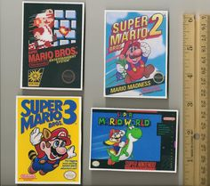 $13 Super Mario Bros. and World Box Art Magnet Set
