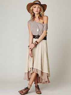 asymetrical raggy edged maxi skirt with darker underskirt, gray off the shoulder baggy shirt, flats, nix the hat.