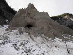 Unique hoodoo formation with a cave in Grotto Valley past Grotto Canyon west of Calgary, Alberta, Canada.
