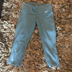 Blue nike crop leggings Super cute Nike crop leggings. Dri fit. Size xs. Excellent condition. 61% cotton, 33% polyester 6% spandex Nike Pants Leggings