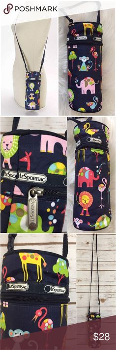 """LESPORTSAC Zoo Cute Baby Multi Bottle Shoulder Bag LeSportsac """"Zoo Cute"""" Baby Multi Bottle Shoulder Bag.   Details:  • A kid-friendly print. • Easy-care nylon. • Adjustable, detachable hands-free strap makes this specially-sized bottle bag a fuss-free addition to your carryall arsenal.  • A zip closure keeps everything contained. • Nylon • Zip closure • Imported  Approximate Measurements:  Height: 8.5'' (H) Maximum strap length: 44'' (L) Bottom Width: 3.5"""" (W) LeSportsac Accessories Bags"""