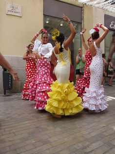 Dancing in the street at feria, Malaga, Spain