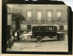 """""""Taking patient from ambulance"""" at Boston City Hospital, November 11, 1928. Boston City Hospital collection (7020.001) For more digitized images from this collection, see here"""
