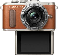 Above, Olympus PEN E-PL8 (Brown) with LCD Facing Forward. Olympus PEN E-PL8 Entry-Level Mirrorless: Stylish, Compact & Lightweight; High-Speed Touch AF; Selfie Mode Activates When LCD Monitor Flips Downward; Video Selfie Mode; e-Portrait Mode to Smooth Skin Tones; Enhance Your Creativity with Olympus Image Palette; Easy Connectivity Via Built-in Wi-Fi and Olympus Image Share Smartphone App http://www.photoxels.com/pr-olympus-epl8/