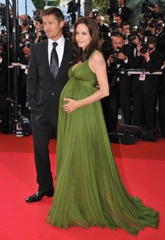 From Grace Kelly to Angelina Jolie: The Most Memorable Red Carpet Moments at the Cannes Film Festival: In Brad Pitt and a very pregnant Angelina Jolie walked the runway, just weeks before she gave birth to twins Knox and Vivienne. Angelina Jolie Dress, Brad Pitt And Angelina Jolie, Jolie Pitt, Pregnant Celebrities, Top Celebrities, Celebs, Maternity Dresses, Maternity Fashion, Celebrity Maternity