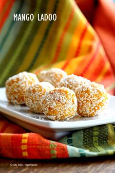 Mango Coconut Ladoo. Fudgy Mango balls made with Mango Puree, Coconut and almond meal. Vegan gluten-free recipe. Easy soy-free dessert or snack.