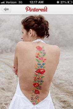 i would definitely do something like this. i believe flowers to be absolutely stunning on the woman's body. -al