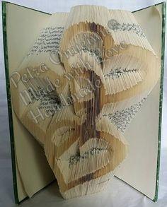 Schneiden und falten von einem Motiv in ein Buch 08 07 2015