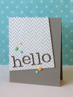 """Setting the front panel on an angle really changes the perspective of this handmade Hello card!  The enamel dots really add a pop of color on this """"3 shades of grey"""" card."""