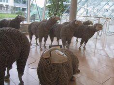 repurposed telephones to make sheep sculptures ! incredible !