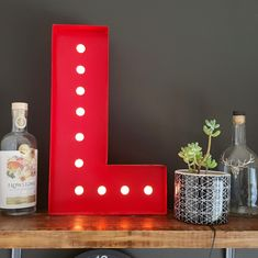 This bold red metal letter Lights will provide a unique and modern design element to your home. The light is not very bright. so its more of a feature light than a room light. Its been handmade by a local craftsman using lazer cut sheet metal, which is then assembled by hand, and then spray painted. Inside the lights are LED strip lights will light up the light holes. The LED Lights are 12v and are power by the supplied 12V transformer. Colour: Red Height: Approx 48cm We can make up and any… Light Letters, Metal Letters, Fiber Cement Board, Geometric Shelves, Plant Shelves, Room Lights, White Enamel, Strip Lighting, Light Up