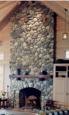 River Stone Fireplace rustic living room with quarry stone fireplace hearth, concrete