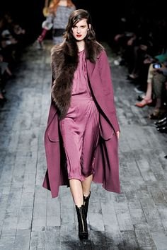 Nina Ricci. I hope that's fake fur. Because this is a pretty sweet outfit. Love the color and shine!